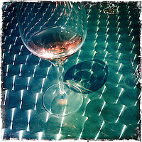 2013 May 13:  Rose wine glass reflection at Artesa in Carneros. Artesa focuses on producing small, ultra-premium lots of the varietals for which the Carneros and the Napa Valley are best known - Chardonnay, Pinot Noir, Merlot and Cabernet Sauvignon.