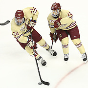 Bill Arnold #24 of the Boston College Eagles controls the puck next to Danny Linell #10 of the Boston College Eagles during The Beanpot Championship Game at TD Garden on February 10, 2014 in Boston, Massachusetts. (Photo by Elan Kawesch)