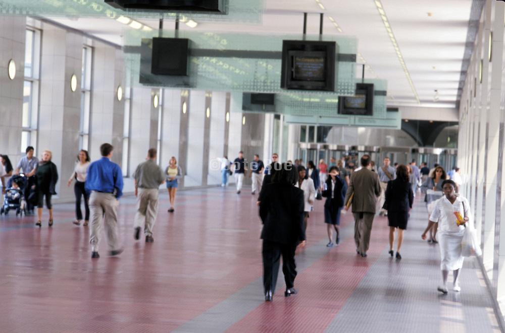 people walking through building overpass