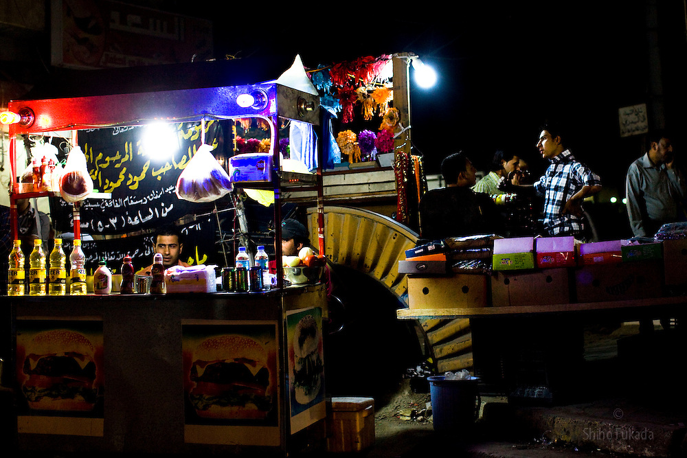 People enjoy night out in Karadah district, Baghdad in Iraq.