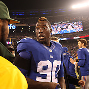 Jason Pierre-Paul, New York Giants at the end of the game during the New York Giants Vs Green Bay Packers, NFL American Football match at MetLife Stadium, East Rutherford, New Jersey, USA. 17th November 2013. Photo Tim Clayton