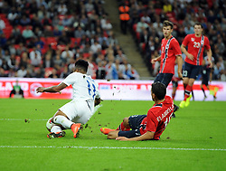 England's Raheem Sterling (Liverpool) is fouled by Norway's Omar Elabdellaoui  resulting in a penalty scored by England captain, Wayne Rooney (Manchester United) - Photo mandatory by-line: Joe Meredith/JMP - Mobile: 07966 386802 - 3/09/14 - SPORT - FOOTBALL - London - Wembley Stadium - England v Norway - International Friendly