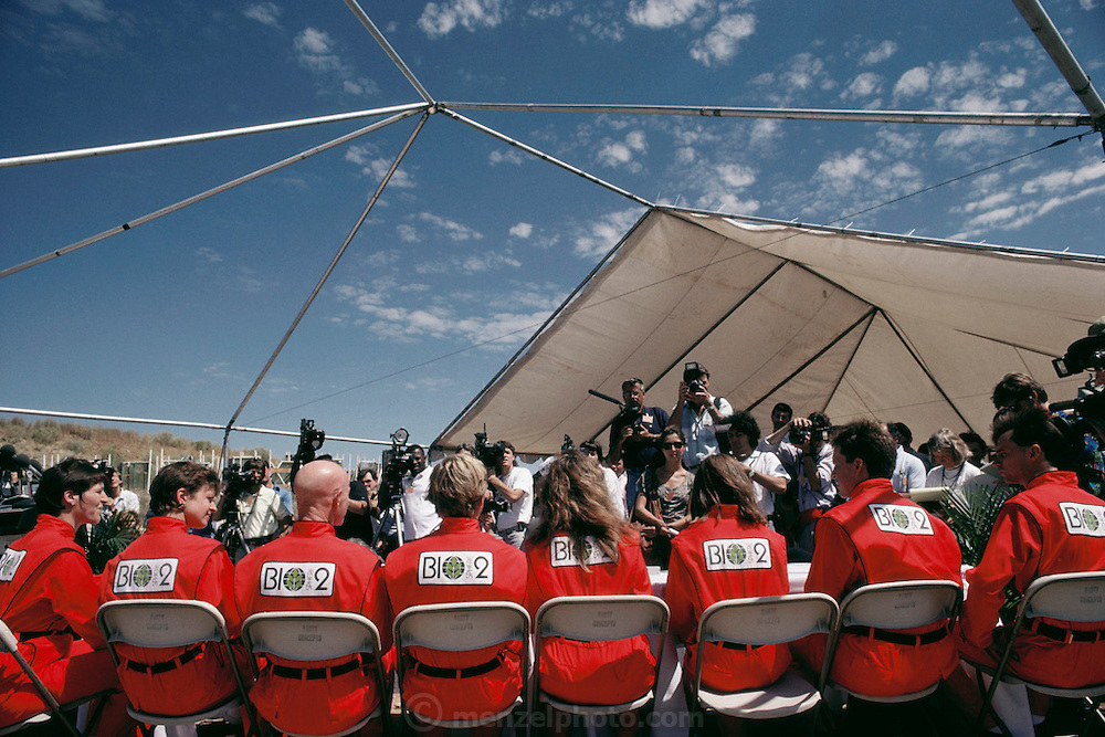 Biosphere 2 Project undertaken by Space Biosphere Ventures, a private ecological research firm funded by Edward P. Bass of Texas. Candidates for 1990's Biosphere 2 project at a press conference just before being sealed inside the Biosphere for two-years. Biosphere 2 was a privately funded experiment, designed to investigate the way in which humans interact with a small self-sufficient ecological environment, and to look at possibilities for future planetary colonization.  1990