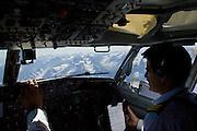 Pilots flying 737 jet airplane over Karokoram mountains above Skardu Valley in Northern Pakistan