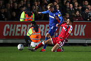 AFC Wimbledon midfielder Mitchell (Mitch) Pinnock (11) battles for possession with Gillingham defender Alfie Jones (14) during the EFL Sky Bet League 1 match between AFC Wimbledon and Gillingham at the Cherry Red Records Stadium, Kingston, England on 23 November 2019.