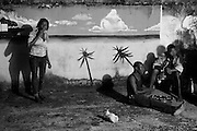 Zanzibar Town, Zanzibar -   2015-03-26  - Sandra, at left, smokes next to a mural at the Detroit Sober House in Zanzibar Town, Zanzibar on March 26, 2015.  Photo by Daniel Hayduk