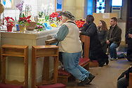 The last visitors pray at the tomb of St. Katharine Drexel at the National Shrine of St. Katharine Drexel Saturday, December 30, 2017 in Bensalem, Pennsylvania. Drexel was an American heiress who dedicating herself to work among the American Indians and African-Americans in the western and southwestern United States. She was canonized a saint by the Roman Catholic Church in 2000. (Photo by William Thomas Cain/Cain Images)