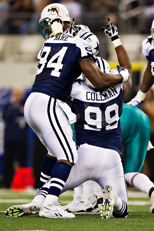 ARLINGTON, TX - NOVEMBER 24:   Kenyon Coleman #99 and DeMarcus Ware #94 of the Dallas Cowboys celebrate after a quarterback sack against the Miami Dolphins at Cowboys Stadium on November 24, 2011 in Arlington, Texas.  The Cowboys defeated the Dolphins  20 to 19.  (Photo by Wesley Hitt/Getty Images) *** Local Caption *** Kenyon Coleman; DeMarcus Ware