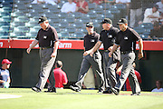 ANAHEIM, CA - AUGUST 21:  Umpires take the field for the Los Angeles Angels of Anaheim game against the Cleveland Indians on Wednesday, August 21, 2013 at Angel Stadium in Anaheim, California. The Indians won the game 3-1. (Photo by Paul Spinelli/MLB Photos via Getty Images)