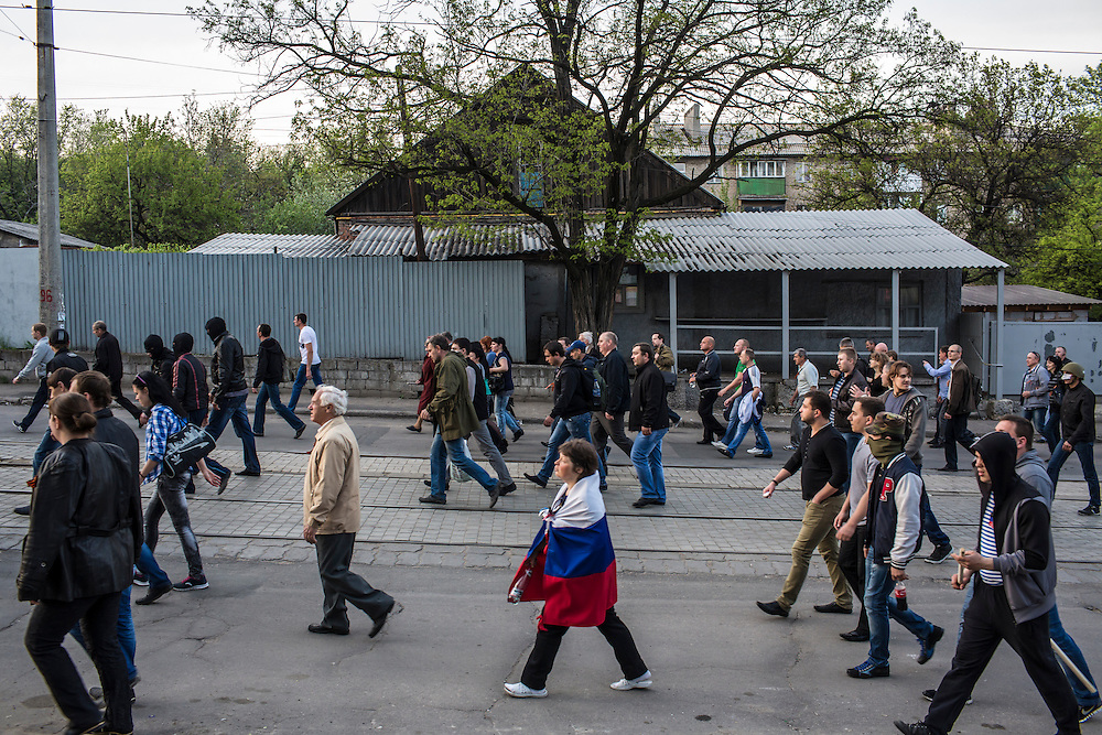 DONETSK, UKRAINE - MAY 4: Pro-Russian protesters march from the military prosecutor's office on May 4, 2014 in Donetsk, Ukraine. Cities across Eastern Ukraine have been overtaken by pro-Russian protesters in recent weeks, leading the Ukrainian military to respond with force in some areas. (Photo by Brendan Hoffman for The Washington Post)