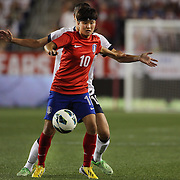 Ji Soyun, Korea Republic, in action during the U.S. Women Vs Korea Republic friendly soccer match at Red Bull Arena, Harrison, New Jersey. USA. 20th June 2013. Photo Tim Clayton