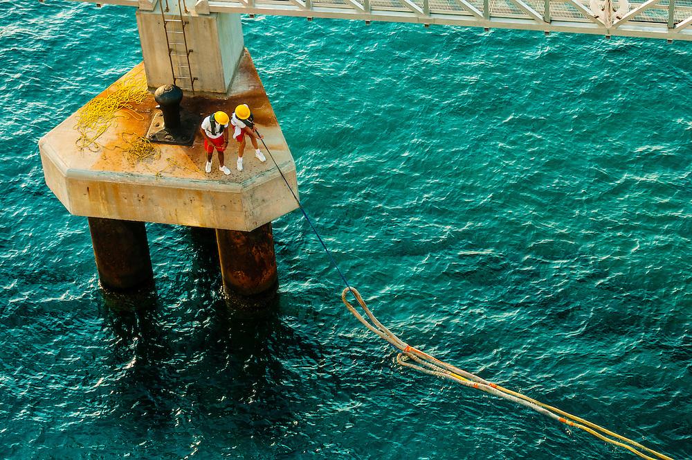 Disney Dream cruise ship docking at Castaway Cay (private Disney island) in the Bahamas.