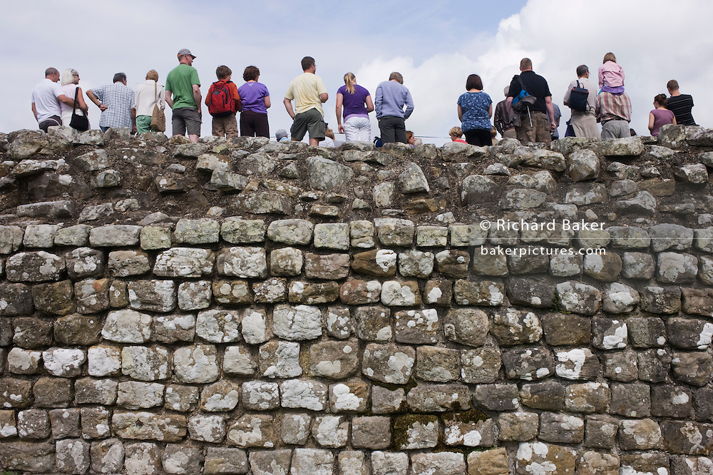 Tourists at Housesteads Fort on Roman Hadrian's Wall, once the northern frontier of Rome's empire from Barbarian tribes.