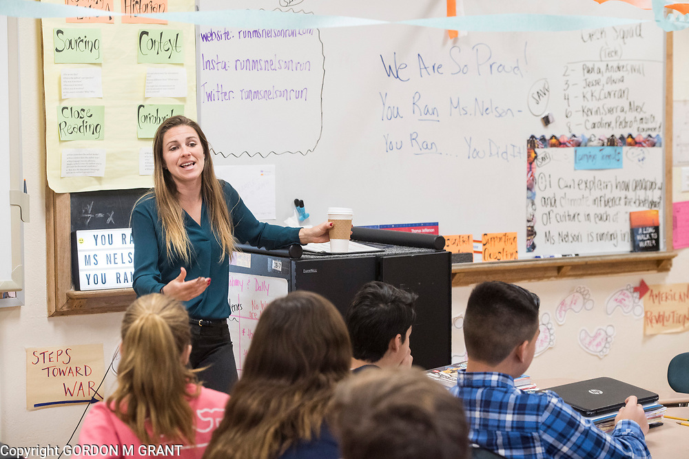Cara Nelson, a seventh grade social studies teacher at East Hampton Middle School, speaks with her students about her recent trip that involved running seven marathons in seven days on seven continents, in East Hampton, Feb. 7, 2018. This was Nelson's first day back to school after finishing her last marathon on Monday in Miami.