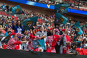 NFL fans dresses as jokers wave the Jacksonville Jaguars flags during the International Series match between Baltimore Ravens and Jacksonville Jaguars at Wembley Stadium, London, England on 24 September 2017. Photo by Jason Brown.