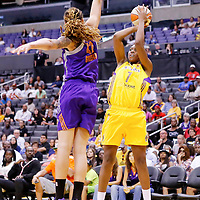 24 August 2014: Los Angeles Sparks forward/center Sandrine Gruda (7) takes a jump shot over Phoenix Mercury center Brittney Griner (42) during the Phoenix Mercury 93-68 victory over the Los Angeles Sparks, in a Conference Semi-Finals at the Staples Center, Los Angeles, California, USA.