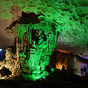 Tourists visit Surprise Cave, Ha Long Bay, Vietnam. The bay consists of a dense cluster of 1,969 limestone monolithic islands. Ha Long Bay, is a UNESCO World Heritage Site, and a popular tourist destination. Ha Long, Bay, Vietnam. 11th March 2012. Photo Tim Clayton