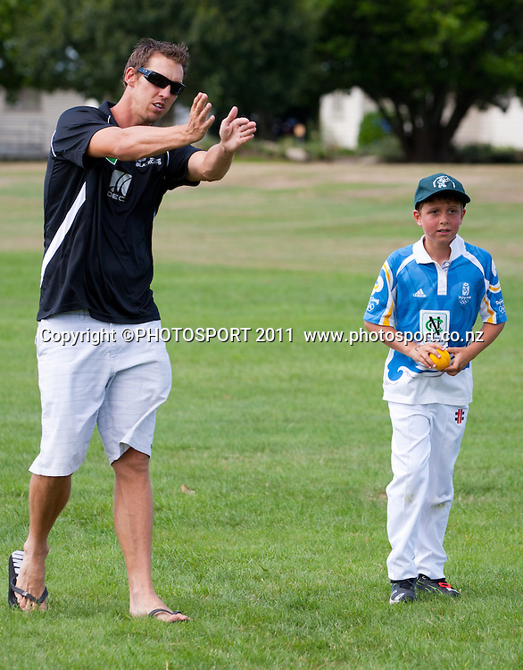 Brent Arnel runs a bowling skill session with Zac Corban, 10, during the NCC Super Camp for Primary School players, an initiative by The National Bank to connect with the grass roots of cricket, hosted by Hamilton Star University Cricket Club, Waikato University, Hamilton, New Zealand, Wednesday 5 January 2011. Photo: Stephen Barker/PHOTOSPORT
