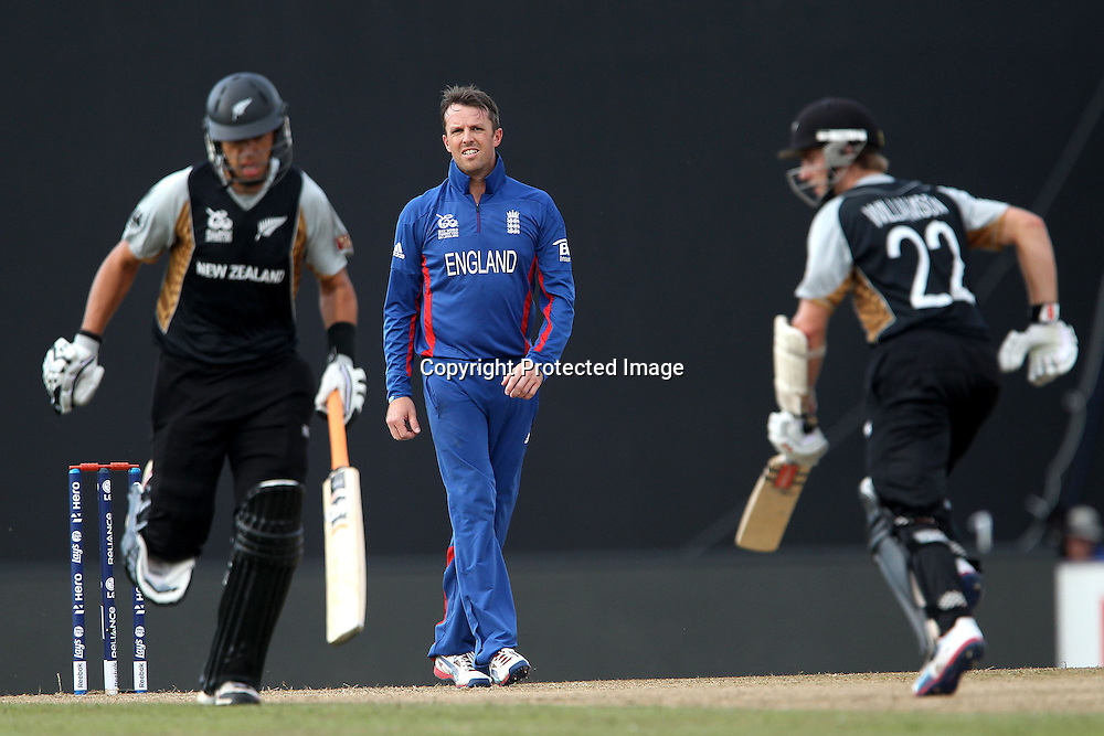 Graeme Swann of England looks on as Kane Williamson and Ross Taylor (Captain) make the runs during the ICC World Twenty20 Super 8s match between England and New Zealand held at the  Pallekele Stadium in Kandy, Sri Lanka on the 29th September 2012<br /> <br /> Photo byRon Gaunt/SPORTZPICS/PHOTOSPORT