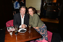 NEIL PEARSON and HAYDN GWYNNE at the West End opening night of 'Great Britain' a  play by Richard Bean held at The Theatre Royal, Haymarket, London followed by a post show party at Mint Leaf, Suffolk Place, London on 26th September 2014.