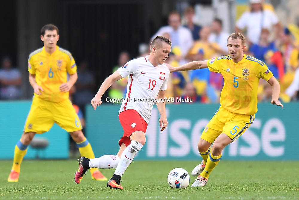 2016.06.21 Marsylia Marseille<br /> Pilka nozna Euro 2016 mecz grupy C<br /> Ukraina - Polska <br /> N/z Piotr Zielinski, Pylyp Budkivskiy<br /> Foto Lukasz Laskowski / PressFocus<br /> <br /> 2016.06.21 Marsylia Marseille<br /> Football UEFA Euro 2016 group C game between Ukraine and Poland<br /> Piotr Zielinski, Pylyp Budkivskiy<br /> Credit: Lukasz Laskowski / PressFocus