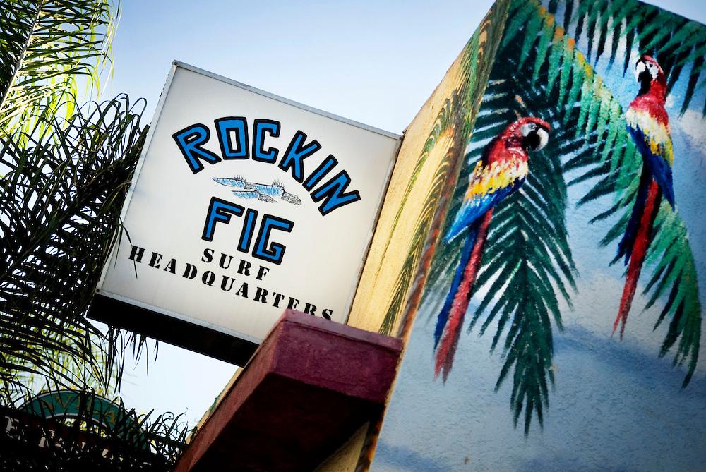 Huntington Beach, California, Surf City, USA..Huntington Beach is a legendary surf beach in California. The surf shop Rockin' Fig Headquarters, run by legendary surfer Rockin Fig, attracts local characters and young surfing talents... ....Photographer: Chris Maluszynski /MOMENT