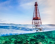 Over/under image of the lighthouse and coral reef of Sombrero Reef off of Marathon, Florida