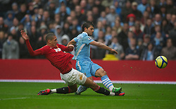 MANCHESTER, ENGLAND - Sunday, January 8, 2012: Manchester City's Sergio Aguero in action against Manchester United's Chris Smalling during the FA Cup 3rd Round match at the City of Manchester Stadium. (Pic by David Rawcliffe/Propaganda)