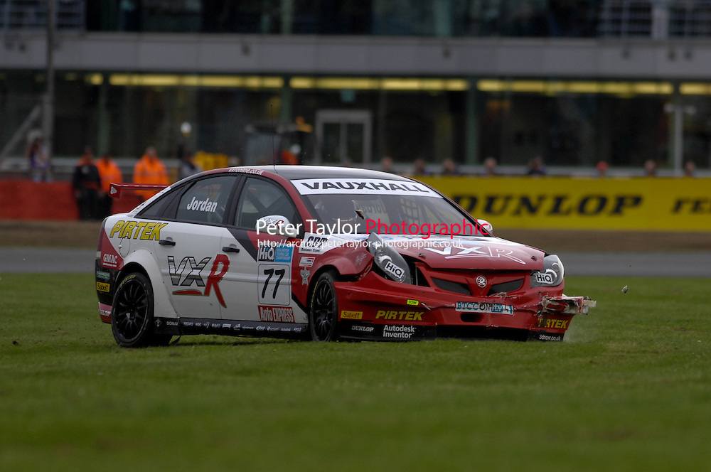 2009 British Touring Car Championship.  Silverstone, Northamptonshire, United Kingdom.  29th-30th August 2009.  (77) - Andrew Jordan (GBR) - VX Racing Vauxhall Vectra, (10) - Tom Chilton (GBR) - Team Aon Ford Focus ST.  World Copyright: Peter Taylor/PSP. Copy of publication required for printed pictures. Every used picture is fee-liable.
