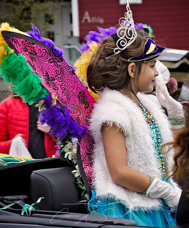 Abigail Robinson, Little Miss Dauphin Island, rides in the Krewe de la Dauphine Mardi Gras Parade, Jan. 28, 2017, in Dauphin Island, Alabama. (Photo by Carmen K. Sisson/Cloudybright)