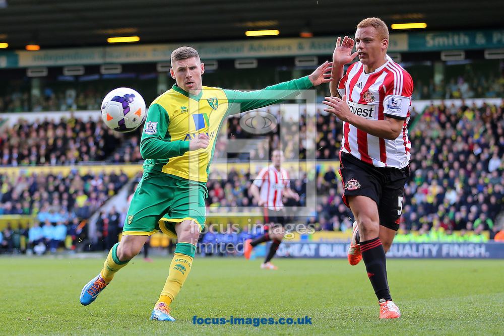 Gary Hooper of Norwich City and Wes Brown of Sunderland during the Barclays Premier League match at Carrow Road, Norwich<br /> Picture by Richard Calver/Focus Images Ltd +447792 981244<br /> 22/03/2014