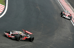 SAO PAULO, BRAZIL - Sunday, November 2, 2008: Lewis Hamilton (GBR, Vodafone McLaren Mercedes) leads from Timo Glock  (GER, Panasonic Toyota Racing) during the Brazilian Formula One Grand Prix at the Interlagos Circuit. (Photo by Juergen Tap/Hochzwei/Propaganda)
