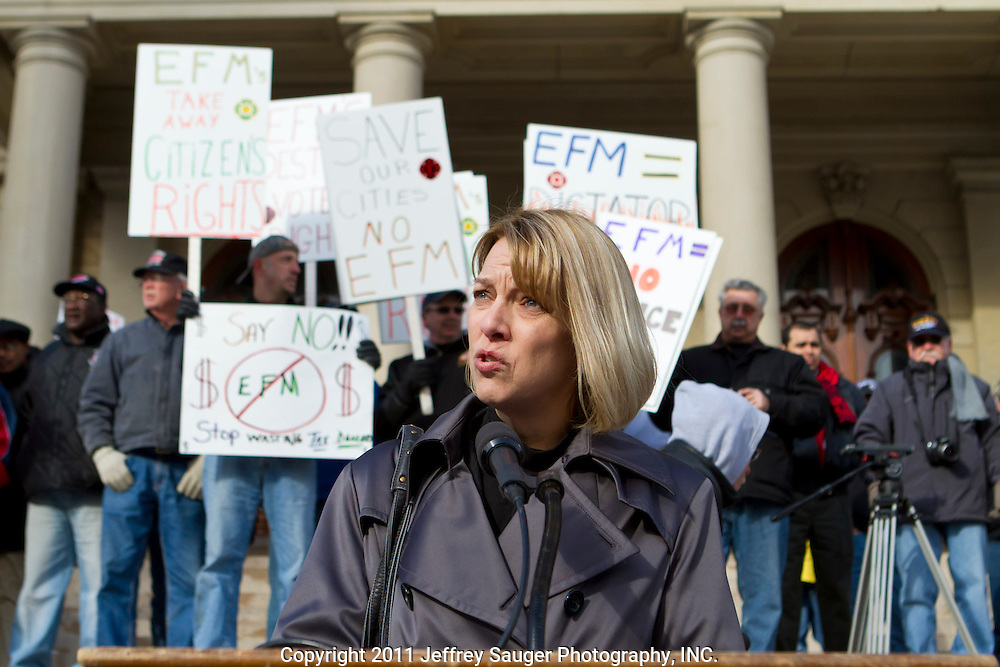 """Beth Sabo, a teacher for 18 years in Lamphere Schools, speaks at a protest against Emergency Financial Manager legislation at the Michigan State Capital in Lansing, MI, Tuesday, March 8, 2011. According to the law, which has already been approved in the House, the governor will be able to declare """"financial emergency"""" in towns or school districts and appoint someone to fire local elected officials, break contracts, seize and sell assets, and eliminate services. Under the law whole cities or school districts could be eliminated without any public participation or oversight. (Jeffrey Sauger/)"""