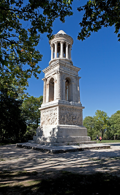 A tower, dedicated as a memorial to the grandsons of Emperor Augustus Caesar, still stands in detailed glory at the ruins of Glanum, on the southern outskirts of St. Remy, Provence, France.