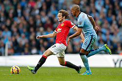 Daley Blind of Manchester United is challenged by Fernando of Manchester City - Photo mandatory by-line: Rogan Thomson/JMP - 07966 386802 - 02/11/2014 - SPORT - FOOTBALL - Manchester, England - Etihad Stadium - Manchester City v Manchester United - Barclays Premier League.