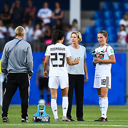 Martina Voss-Tecklenburg head coach of Germany and Sara Doorsoun of Germany and Melanie Leupolz of Germany celebrates the victory during the Women's World Cup match between Germany and South Africa at Stade de la Mosson on June 17, 2019 in Montpellier, France. (Photo by Alexandre Dimou/Icon Sport)