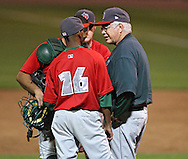 TinCaps pitching coach Tom Bradley talks with his players in game three of the Midwest League Championship at Community Field in Burlington, Iowa on September 17, 2009.