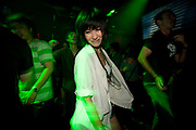ASIAN GIRL IN CLUB SMILING/GRINNING GREEN LIGHTING