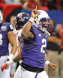 TCU Horned Frogs quarterback Trevone Boykin (2) celebrates a first down against the Mississippi Rebels in the first half of their Chick-fil-A Peach Bowl football game at the Georgia Dome on December 31, 2014. David Tulis / Abell Images for the Chick-fil-A Bowl