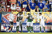 FRISCO, TX - JUNE 26:  Frederic Piquionne #10 of the Portland Timbers celebrates with his teammates after scoring a goal against FC Dallas on June 26, 2013 at FC Dallas Stadium in Frisco, Texas.  (Photo by Cooper Neill/Getty Images) *** Local Caption *** Frederic Piquionne