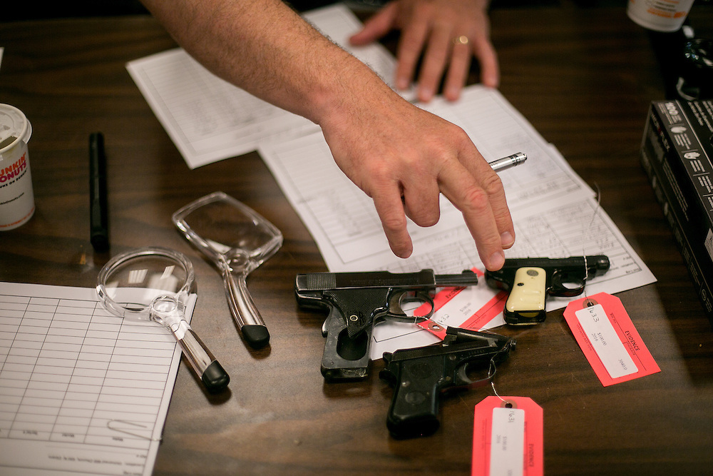 CHICAGO, IL - MAY 28, 2016: Chicago Police Department officer Kenneth Yakes processes weapons at a gun buyback at the Universal Missionary Baptist Church in Chicago, Illinois. CREDIT: Sam Hodgson for The New York Times.