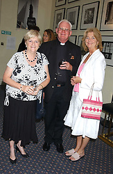 Left to right, ANN WIDDECOMBE MP, her brother CANON MALCOLM WIDDECOMBE and his wife MERYL WIDDECOMBE at a party to celebrate the publication of 'An Act of Peace' by Ann Widdecombe at 11 Carlton House Terrace, London on 19th July 2005.<br />