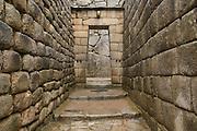 Stone doorway near Temple of the Sun, Machu Picchu, Peru.