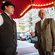 05/31/2013  BOSTON, MA    Doorman Dan Flaherty (cq) (left) speaks with Serge Denis (cq), Managing Director of The Langham, Boston (cq), at The Langham, Boston (cq). Denis is retiring after 40 years in the hotel business.   (Aram Boghosian for The Boston Globe)
