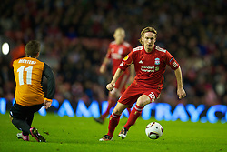 LIVERPOOL, ENGLAND - Wednesday, December 15, 2010: Liverpool's Christian Poulsen in action against FC Utrecht during the UEFA Europa League Group K match at Anfield. (Photo by: David Rawcliffe/Propaganda)