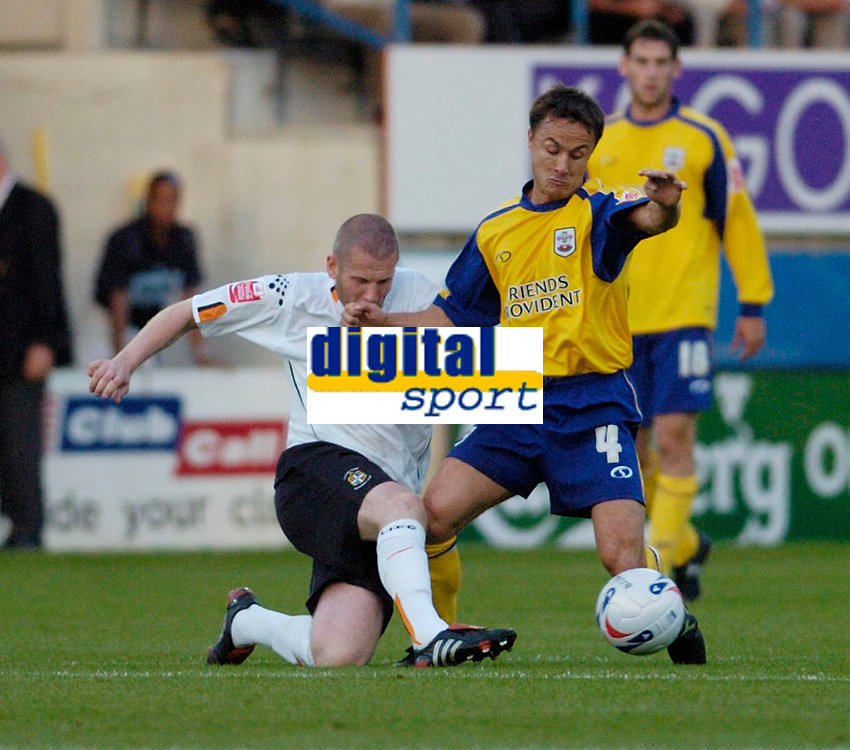Photo: Leigh Quinnell.<br /> Luton Town v Southampton. Coca Cola Championship.<br /> 09/08/2005.Southampton Dennis Wise is tackled by Lutons Kevin Nicholls.
