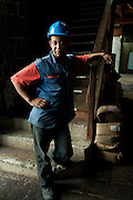 Mauritius. Rico works in the Laifat Fur Bros. & Co. China Town.