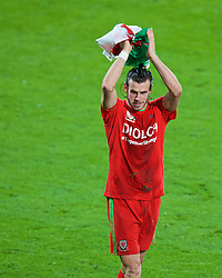 CARDIFF, WALES - Tuesday, October 13, 2015: Wales' Gareth Bale celebrates on the pitch after qualifying for the finals following a 2-0 victory over Andorra during the UEFA Euro 2016 qualifying Group B match at the Cardiff City Stadium. (Pic by Paul Currie/Propaganda)