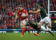 Wales George North breaking a tackle from South Africa's Bryan Habana during the Rugby World Cup Quarter Final match between South Africa and Wales at Twickenham, Richmond, United Kingdom on 17 October 2015. Photo by Matthew Redman.