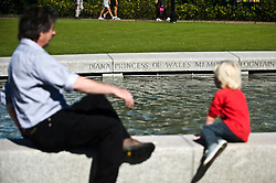 © Licensed to London News Pictures. 31/08/2012. London,UK. A boy playing on the Diana Memorial Fountain in Hyde Park on on August 31, 2012, the anniversary of the death of Princess Diana. Diana, Princess of Wales, was killed in a car crash in Paris 15 years ago. Photo credit : Thomas Campean/LNP....